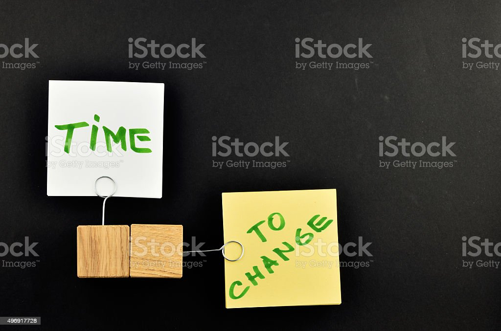 Time to change, Two paper notes on black background royalty-free stock photo