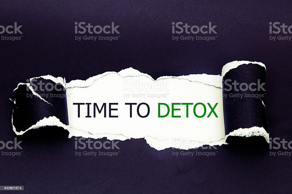 time to detox written under torn paper stock photo