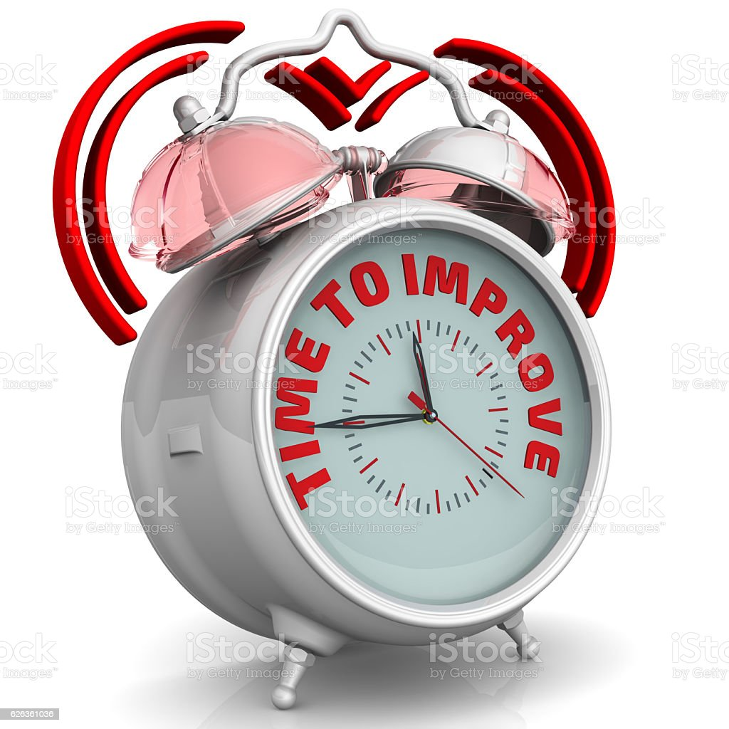 Time to improve. The alarm clock with an inscription stock photo