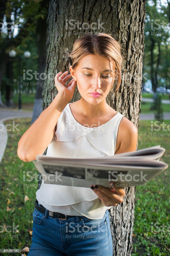 Time to inform herself! stock photo