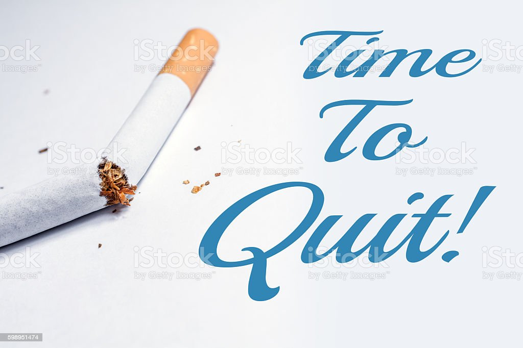 Time To Quit Smoking Reminder With Broken Cigarette In Whitebox stock photo