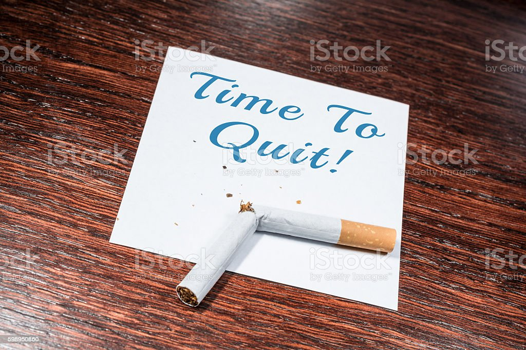 Time To Quit Smoking Reminder With Broken Cigarette On Shelf stock photo