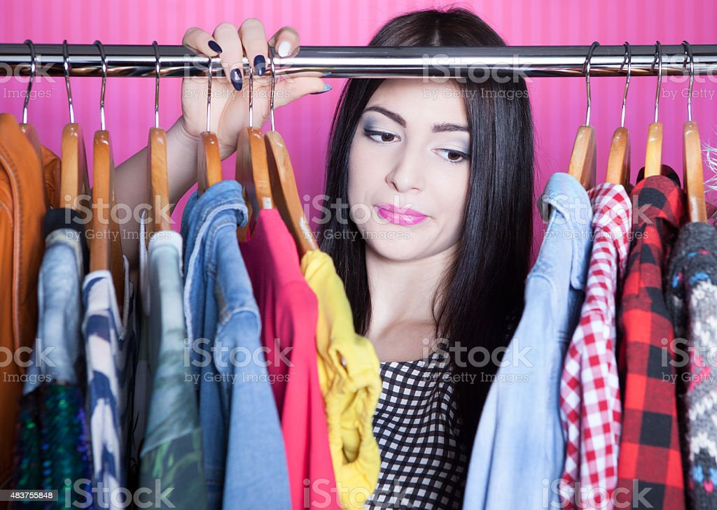 Time to refresh wardrobe young attractive disappointed woma stock photo