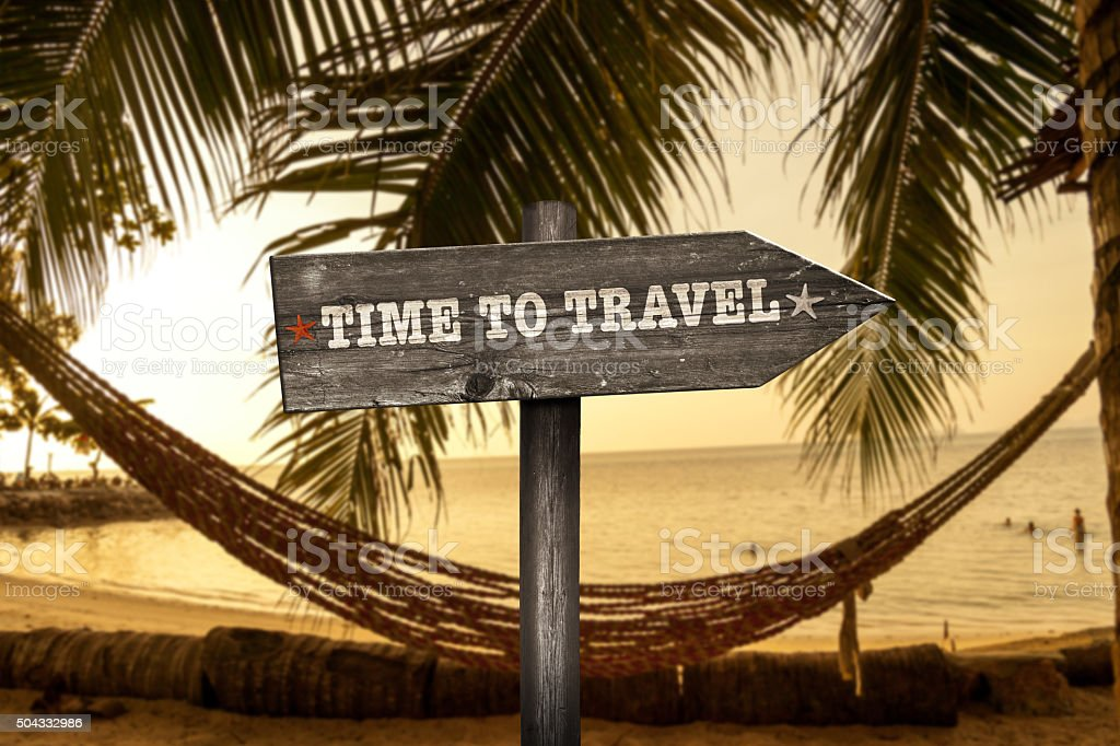 Time to Travel wooden sign with holiday background stock photo