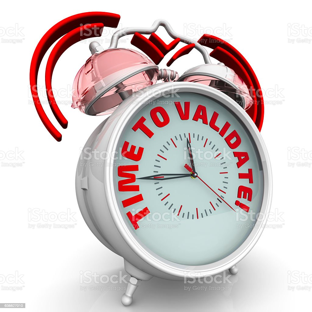 Time to validate! The alarm clock with an inscription stock photo