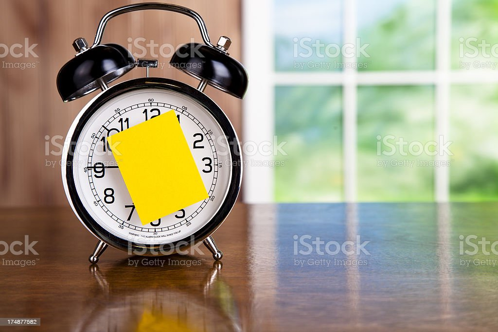 Time:  Two bell alarm clock on wooden table. stock photo