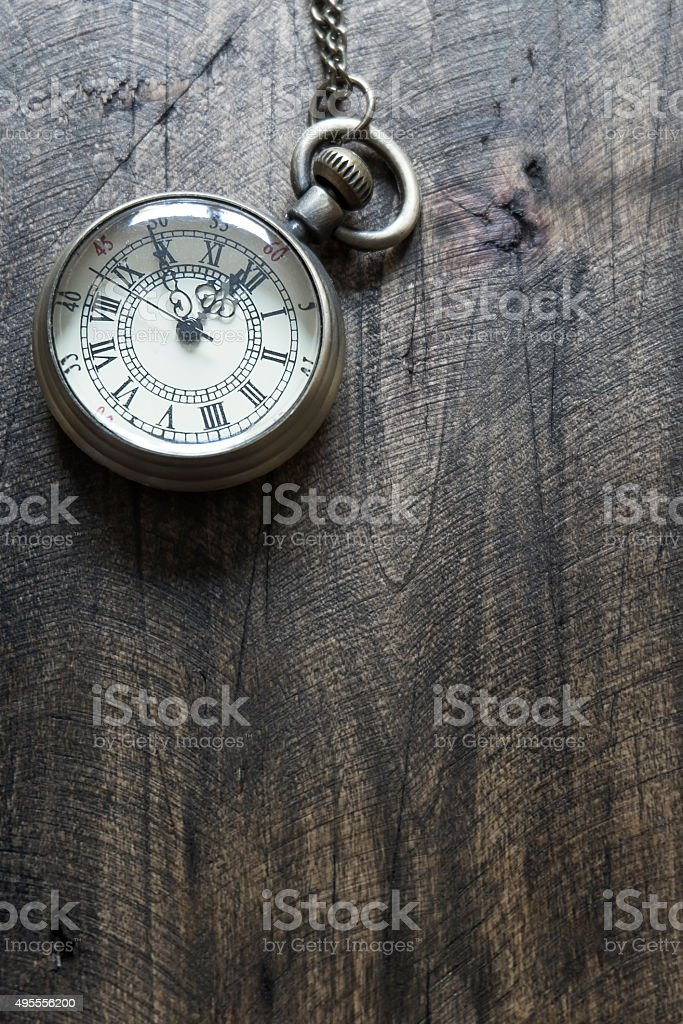 Time - Vintage Pocket Watch on Weathered Wood Background stock photo