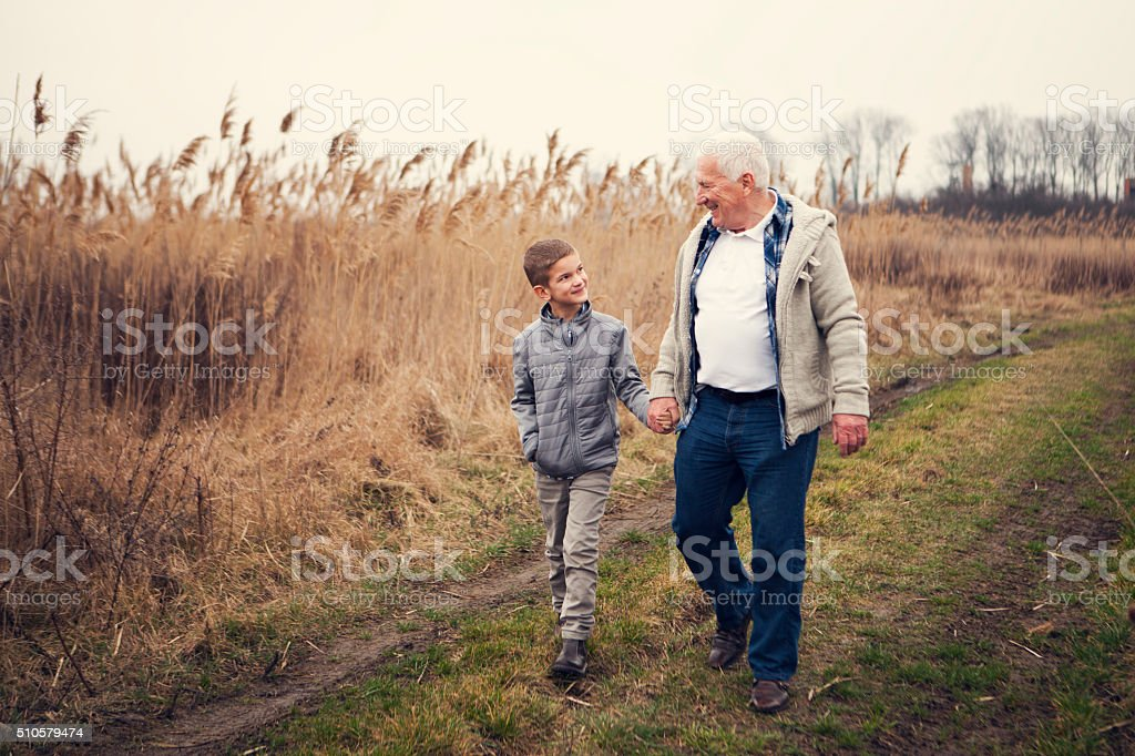 Time with my grandpa in countryside stock photo