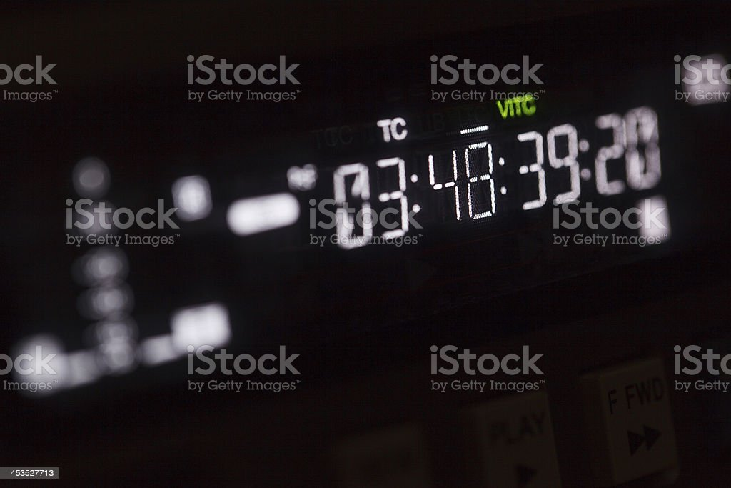 Timecode running on the professional video recorder. stock photo