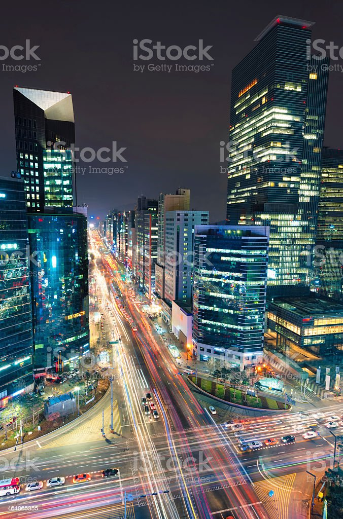 Timelapse of Gangnam city skyscrapers and traffic at night stock photo
