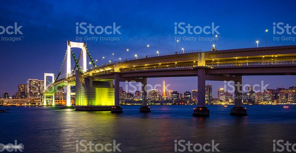 Timelapse of rainbow bridge at night, Tokyo, Japan stock photo