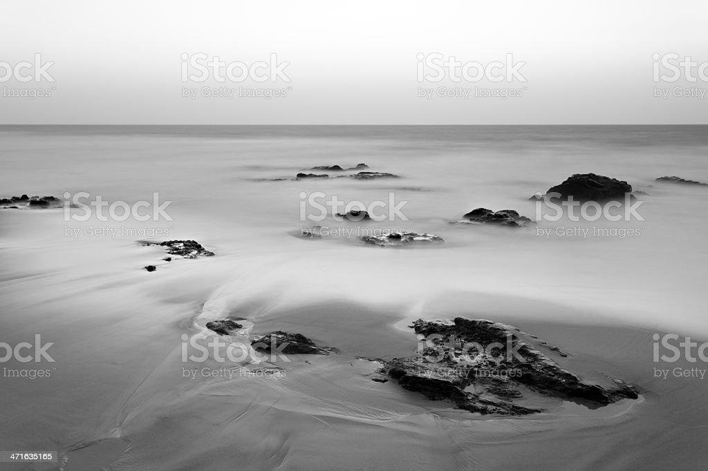 Timeless Beach With Rocks Long Exposure stock photo