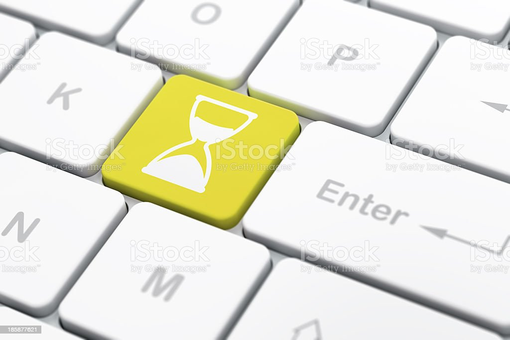Timeline concept: Hourglass on computer keyboard background royalty-free stock photo