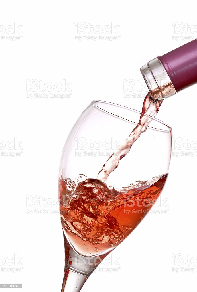 Timely photo captured of pouring wine royalty-free stock photo