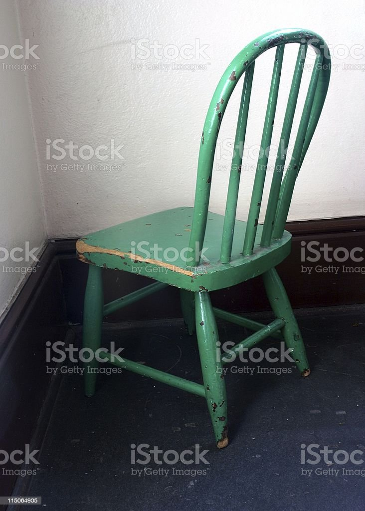 time-out chair in a corner stock photo