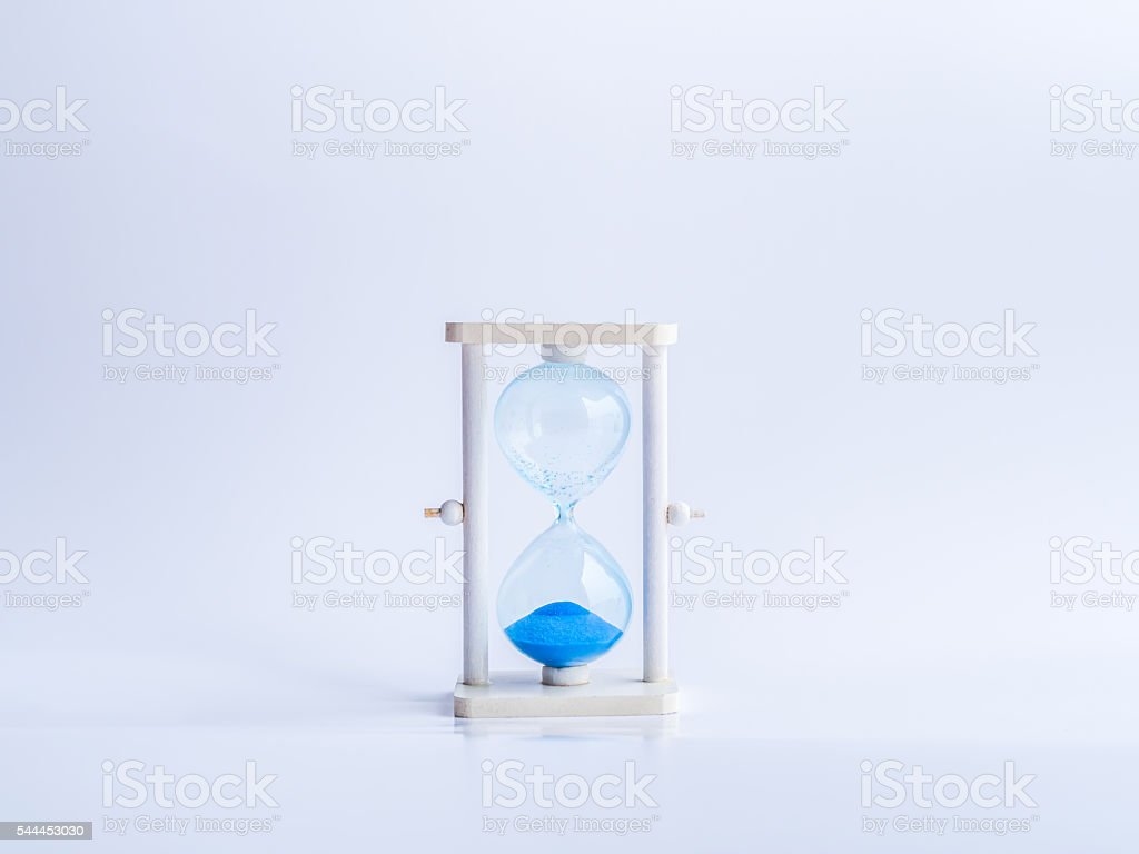 Timeout hourglass and gray background. stock photo