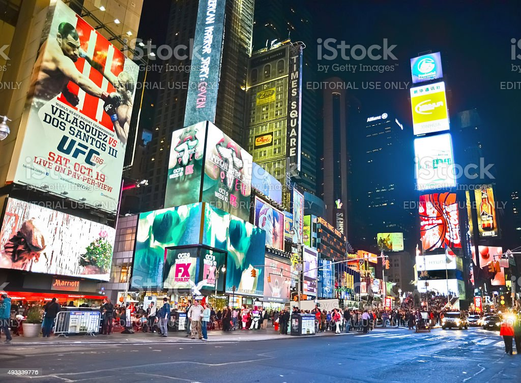 Times Square at night in New York City stock photo