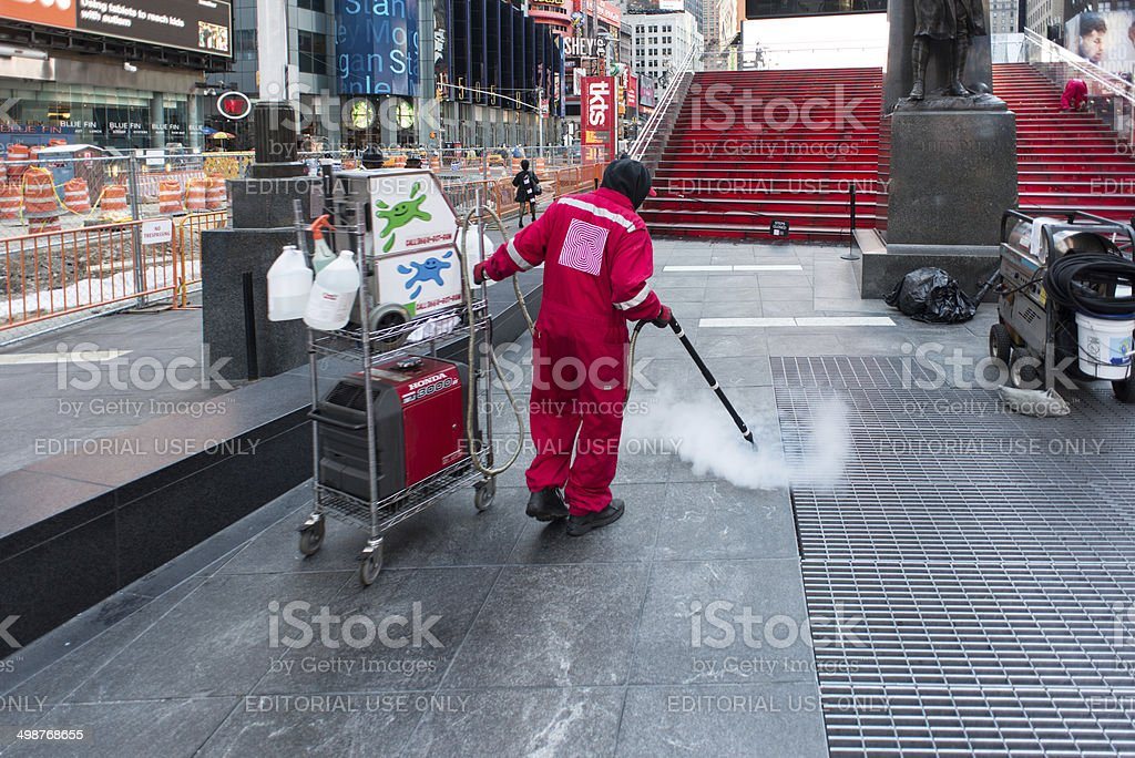 NYC Times Square - bubble gum removing stock photo