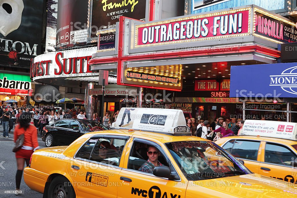 Times Square evening taxi cabs and theater district billboards stock photo