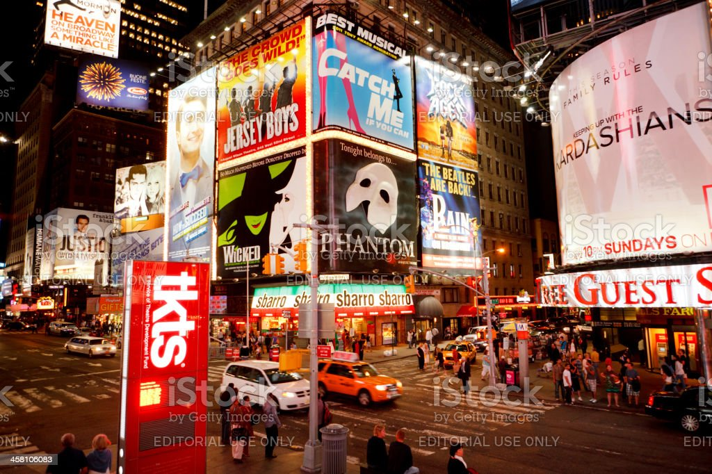 Times Square Iluminated Billboards at Night in New York City royalty-free stock photo