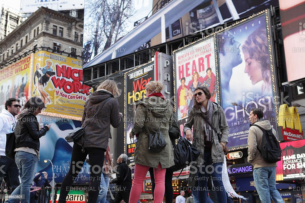 Times Square NYC girls and Broadway show billboards stock photo