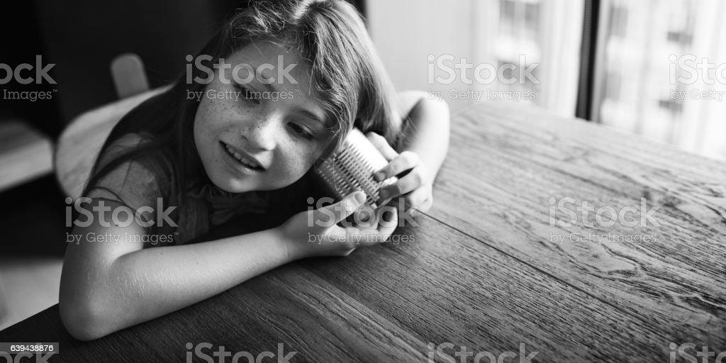 Tin Can Phone Girl Concept stock photo