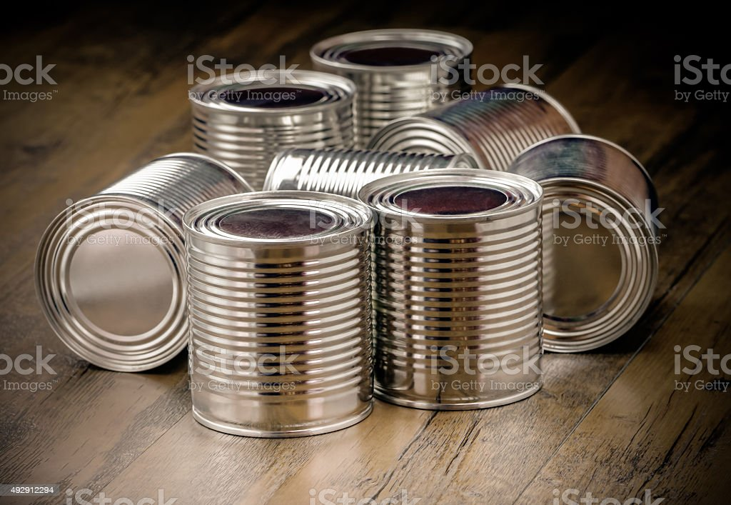 Tin cans for food on wooden background stock photo