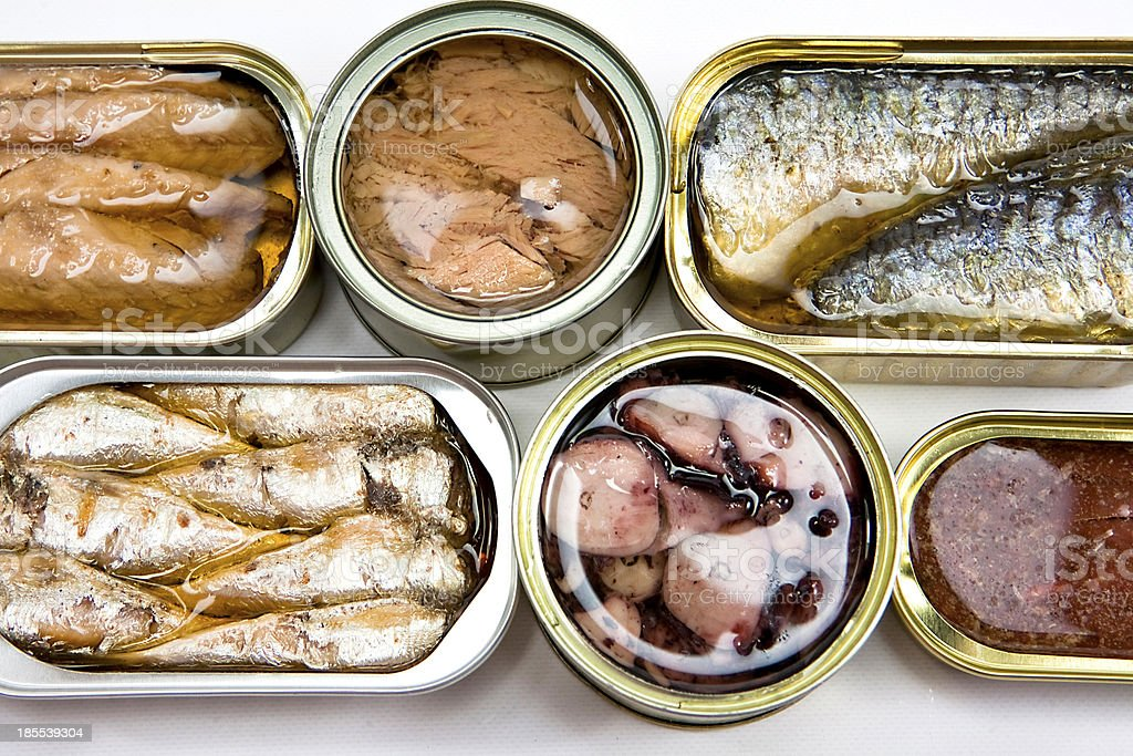 Tin cans full of seafood type foods like tuna and sardines stock photo
