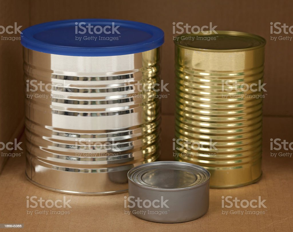 Tin Cans in a Cardboard Box royalty-free stock photo