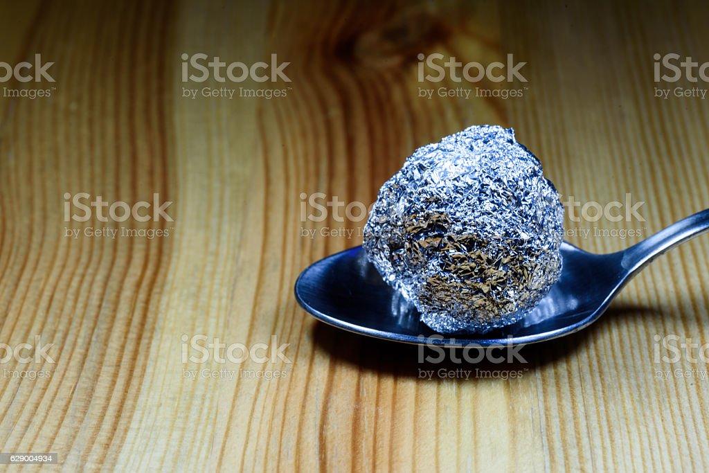 Tin Foil Heroin Lump on Silver Spoon stock photo