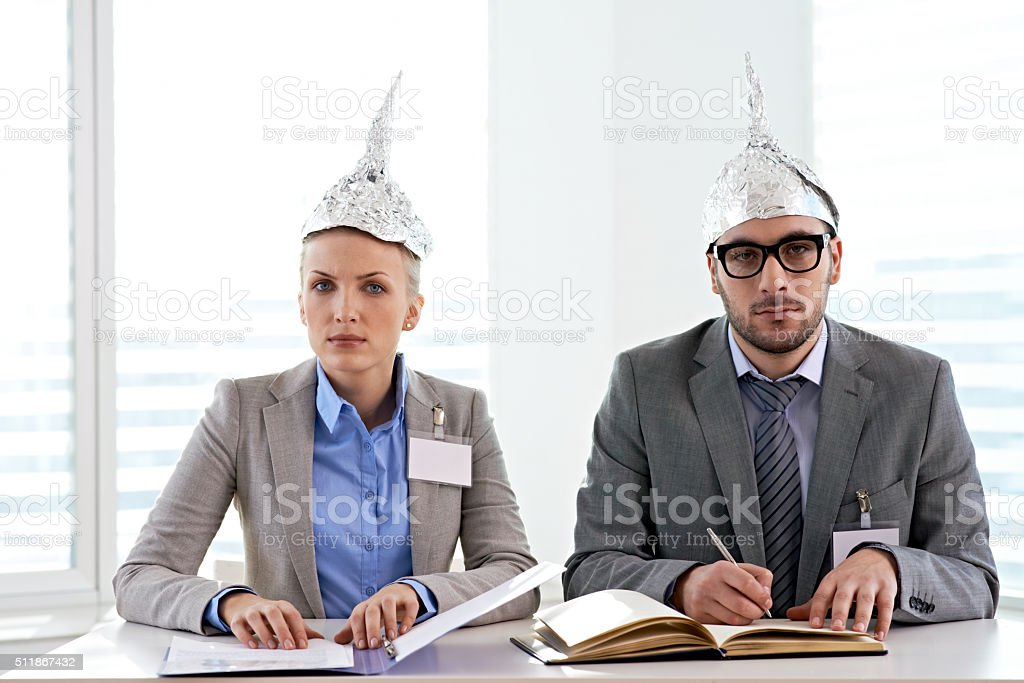 Tin foiled business couple stock photo
