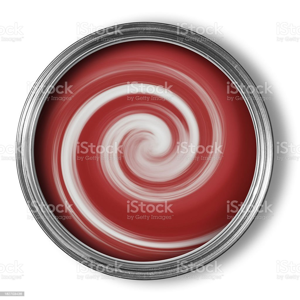 Tin of red paint being mixed with swirls on white royalty-free stock photo