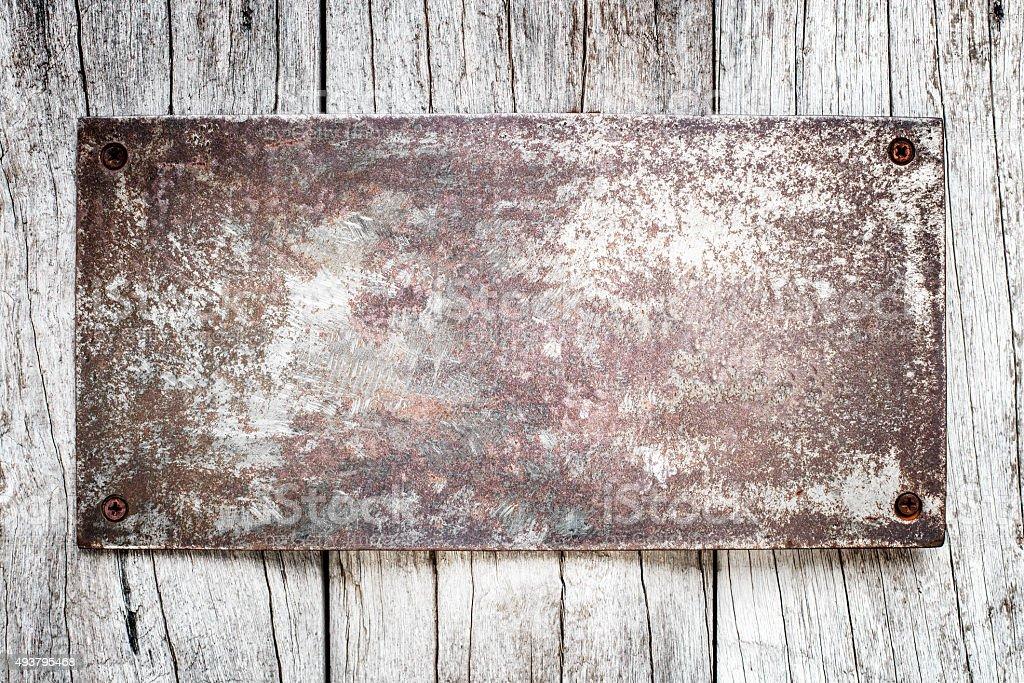Tin Sign on wood background stock photo