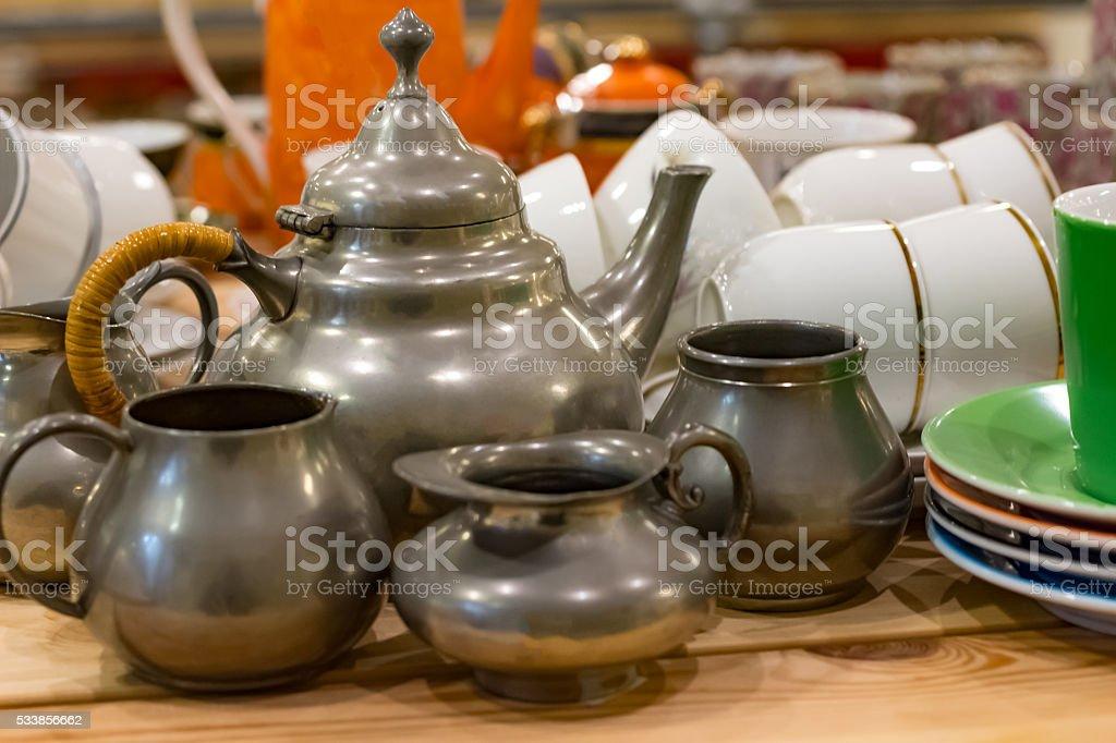 Tin teapot with milk jugs stock photo