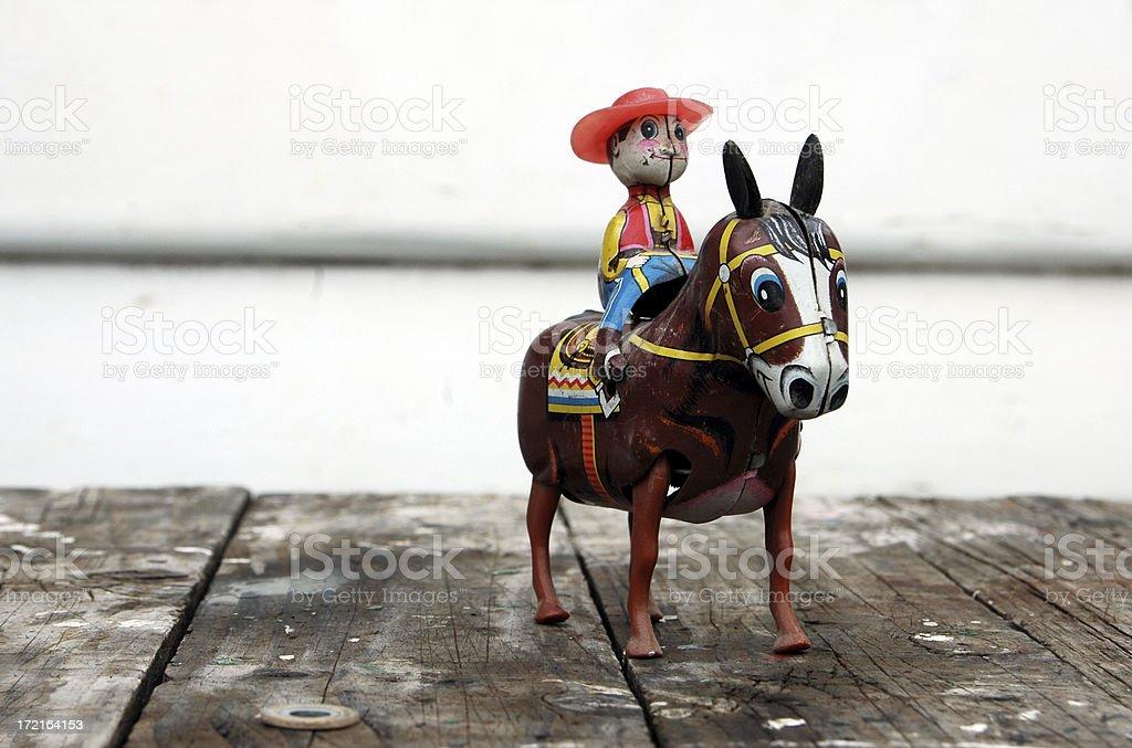 tin toy cowboy stock photo