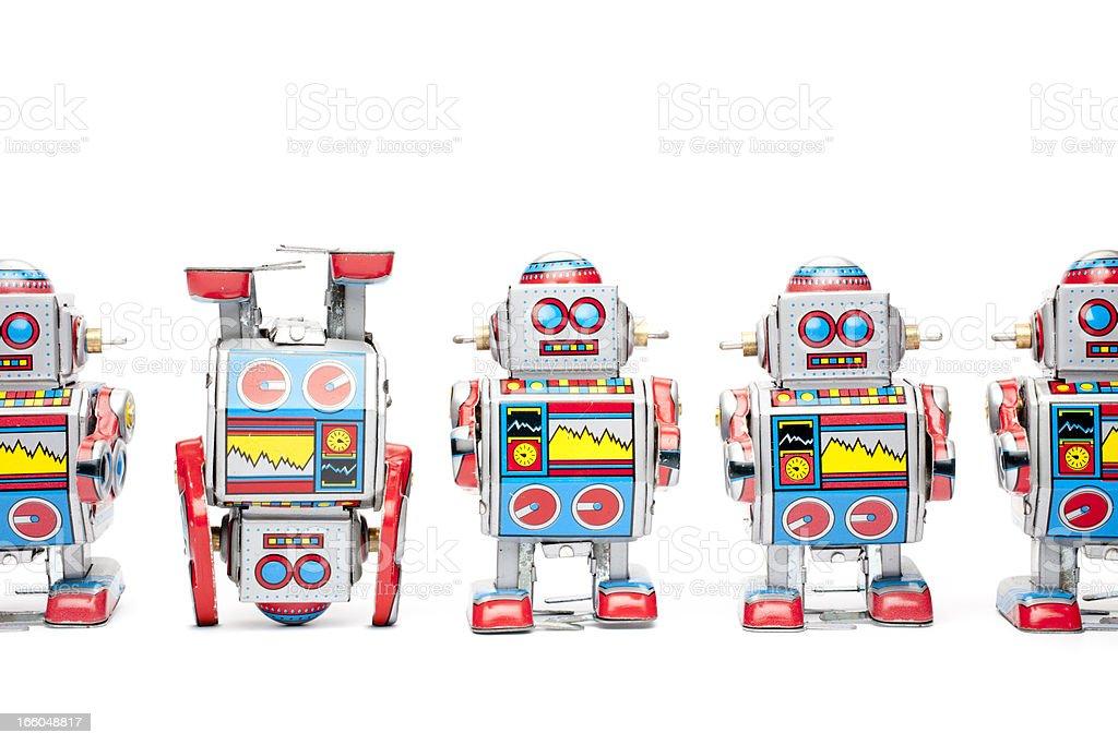 Tin toy robots - Upside down royalty-free stock photo