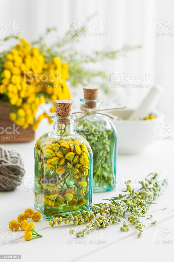 Tincture bottles of tansy and tarragon healthy herbs stock photo