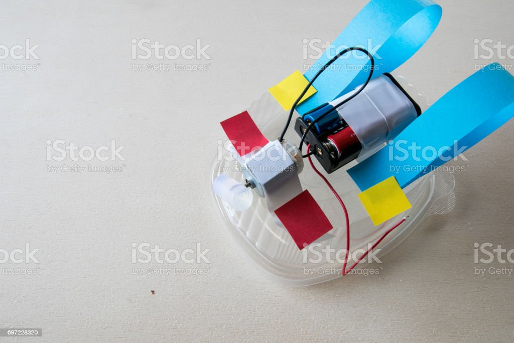 Tinkering activity robot from waste stock photo