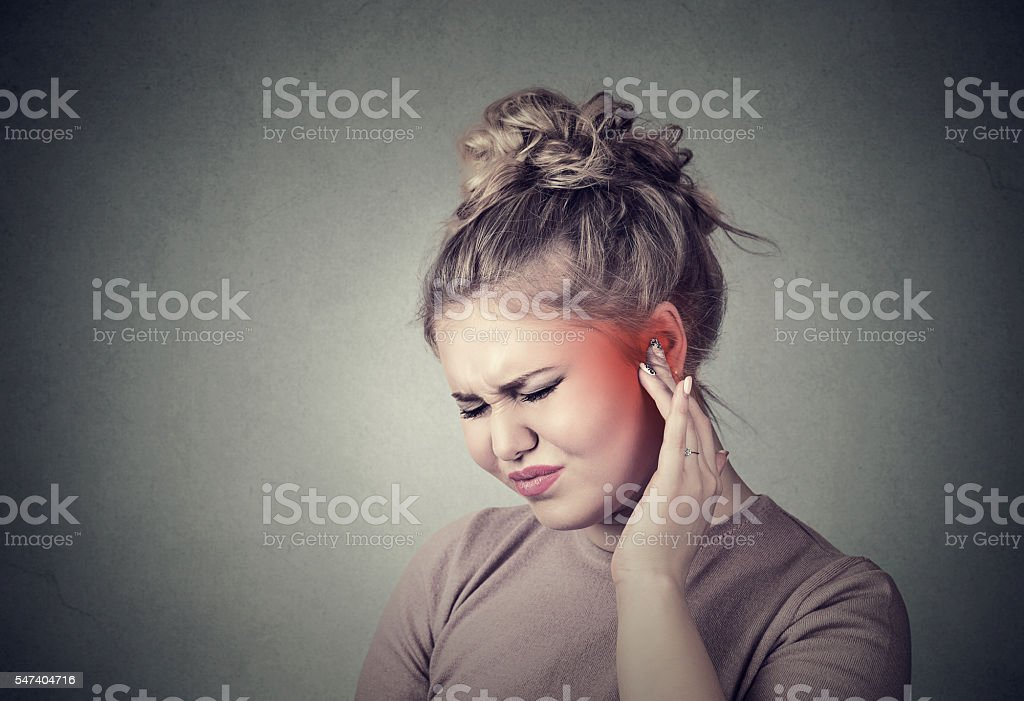 Tinnitus. Closeup up side profile sick female having ear pain...