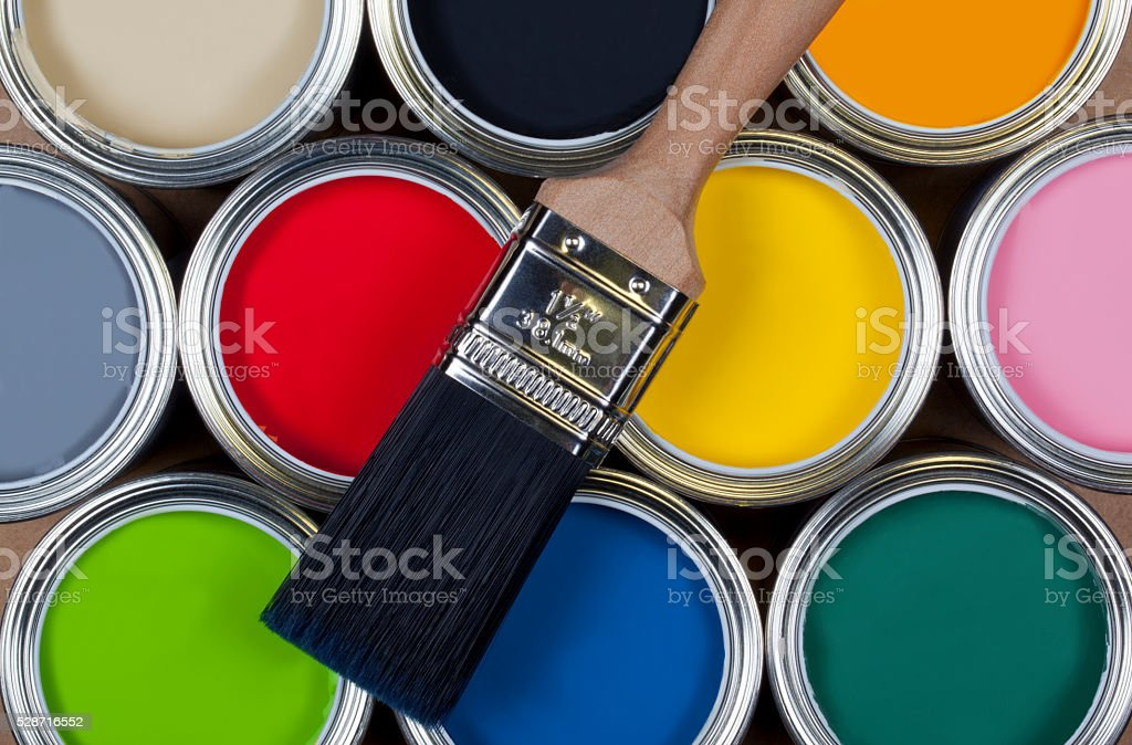 Tins of colorful paint stock photo