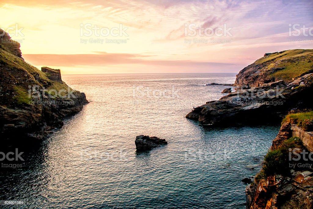 Tintagel castle ruins sunset stock photo