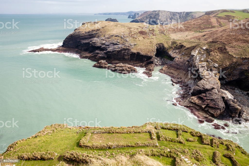 Tintagel Caves and foundations of dwellings at Tintagel. stock photo