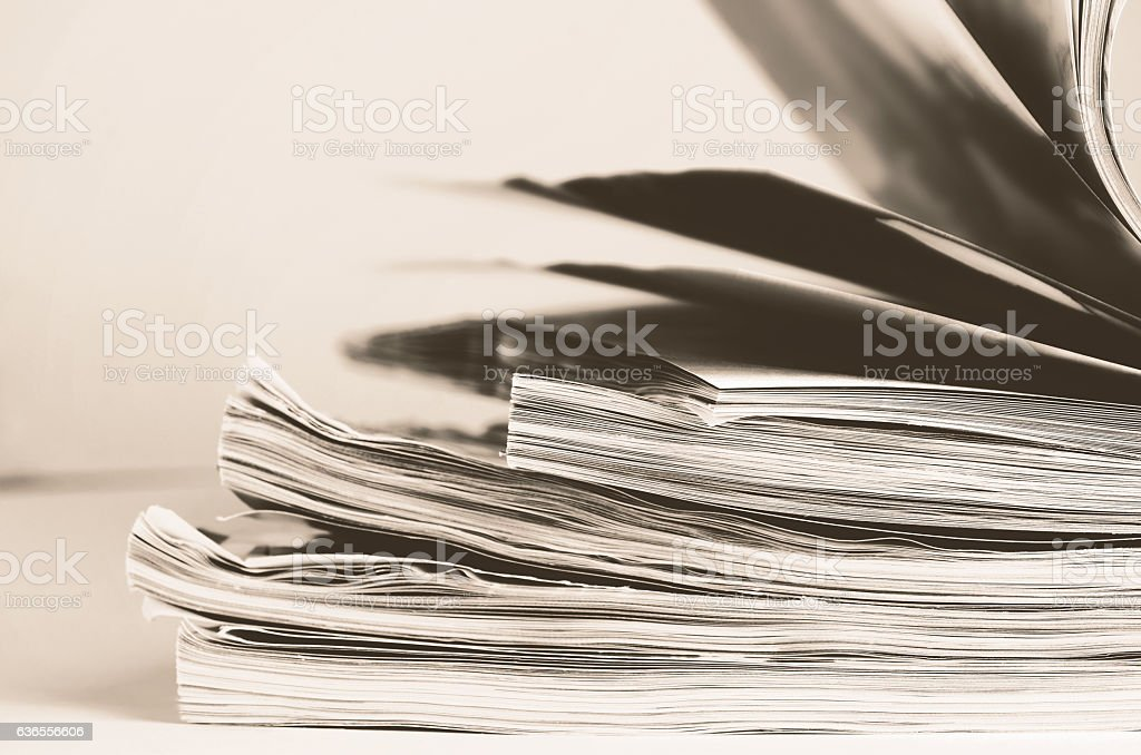 tinted image stack of magazines to turn pages stock photo