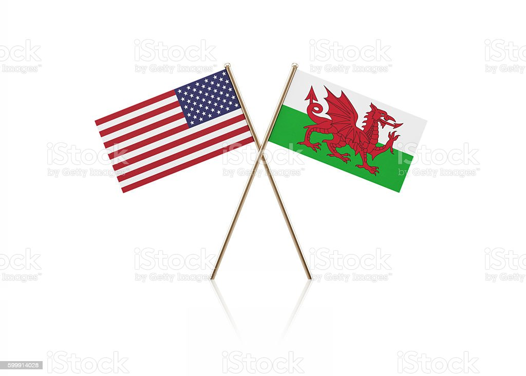 Tiny American and Welsh Flag Pair on Gold Sticks stock photo