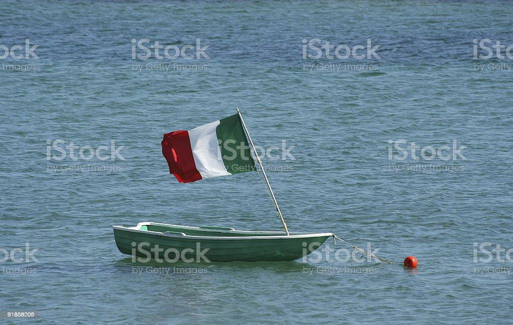 Tiny boat with Italian flag royalty-free stock photo