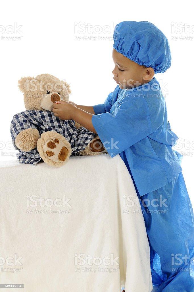 Tiny Doc Giving Meds royalty-free stock photo