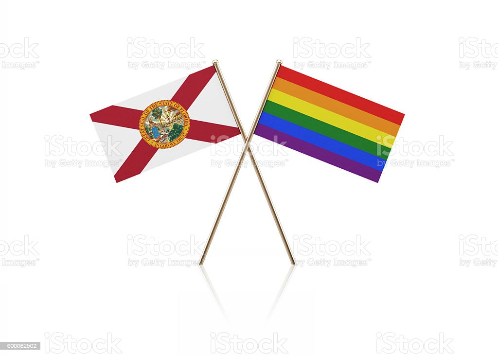 Tiny Florida and LGBT Flag Pair on Gold Sticks stock photo