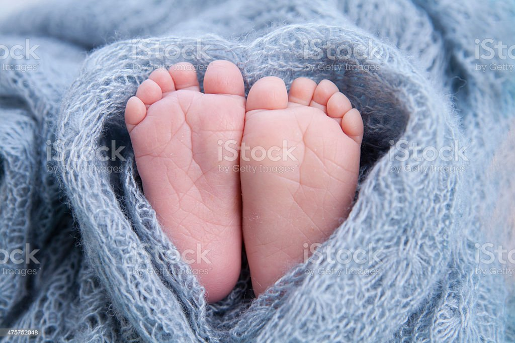 tiny foot of newborn baby stock photo