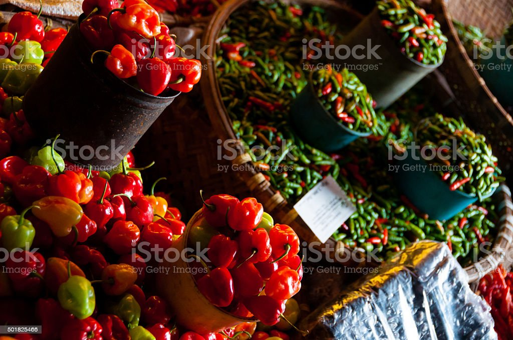 Tiny Fresh red green and orange habanero chillies at a stock photo