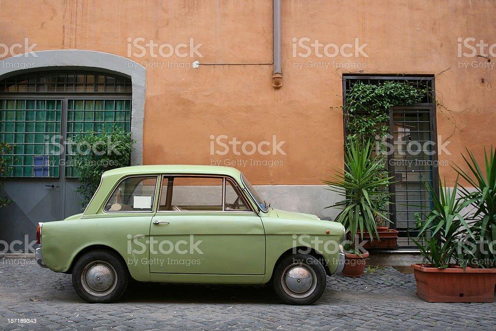Tiny green Italian vintage car royalty-free stock photo